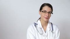 Doctor on white showing different expressions Stock Footage