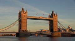 Timelapse Tower Bridge sunset London landmark orange light ship cruise pass day Stock Footage