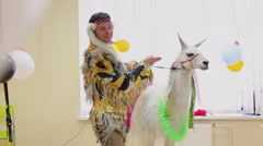 Man in barbarian costumes performs with lama Stock Footage