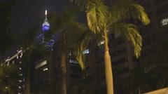 Palm trees in downtown Taipei - Taipei 101 pan Stock Footage