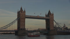 Traffic car Tower Bridge Thames River twilight boat cruise pass London icon day Stock Footage