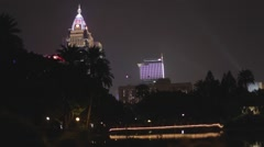 Far glory financial building by the lake at night-  pan Stock Footage
