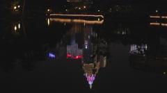 Far glory financial building - lake reflection Stock Footage