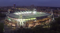Locomotive sports stadium against cityscape with traffic - stock footage