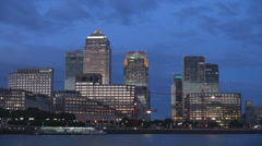 Canary Wharf Thames River tourist attraction twilight blue sky London business  Stock Footage