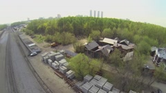 Building materials lay near railway and city on horizon Stock Footage