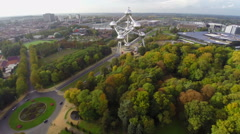 Atomium in Brussels park, aerial shot, autumn fall above view Stock Footage
