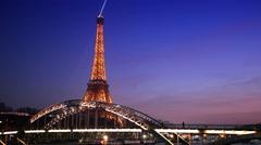 Eiffel Tower and  bridge Passerelle Debilly illuminated, view from  Seine quay Stock Footage