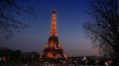 Eiffel Tower and the bridge Passerelle Debilly illuminated, view from Seine quay Stock Footage
