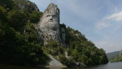 Giant rock carving Danube river tracking Stock Footage