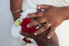 rings on wedding bouquet - stock photo