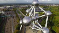 Huge atoms of Atomium Belgium aerial shot, city view, museum Stock Footage