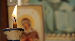 Candle before an icon Stock Footage