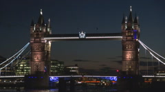 Tower Bridge closeup night illuminated London icon twilight traffic car boat UK Stock Footage