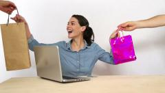 Young woman buy clothing items online Stock Footage