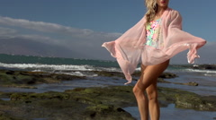swimsuit model on windy Maui beach Stock Footage
