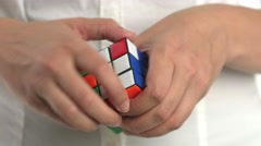Model playing with rubik's cube Stock Footage