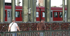 Ultra HD 4K High Speed Train Passing Commuters People Walk Cologne Famous Bridge Stock Footage