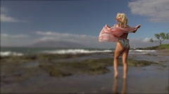 Maui beach in the wind with a bikini model Stock Footage