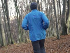 Young man jogging in autumn forest super slow motion, shot at 240fps NTSC Stock Footage