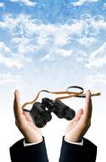 Stock Photo of smart vision concept, binocular in hand