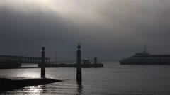 Dark foggy Lisbon morning ferry docks.mp4 Stock Footage