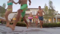 GoPro Shot Of Teens Running And Jumping In Pool (Camera Follows Them Underwater) Stock Footage
