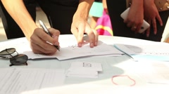 Boy fill out forms, questionnaires, staing at the table Stock Footage