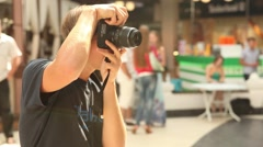 Young sexy photographer making photo in the mall Stock Footage