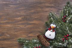 Wood background with a seasonal winter holiday theme - stock photo