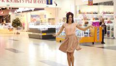 Young beautiful girl walking in the mall Stock Footage