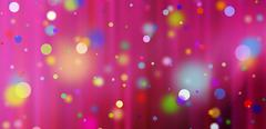 Confetti against a red blurred curtain background Stock Illustration