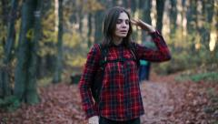 young woman looking for direction in the autumn forest HD - stock footage