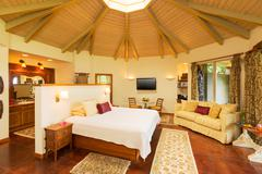 bedroom with hardwood floors - stock photo