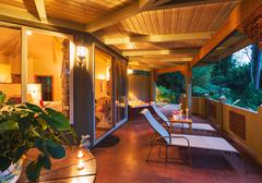 Romantic deck on tropical home at sunset Stock Photos