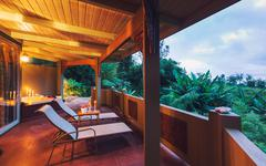 romantic deck on tropical home at sunset - stock photo