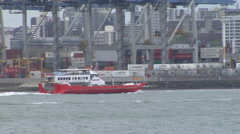 Sealink Ferry going past container terminal Stock Footage