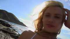 Swim suit model portrait on a windy Maui beach Stock Footage