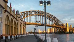 Sun sets on Sydney Harbour Bridge and the City Stock Footage