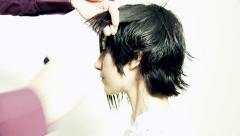 Female model getting short haircut Stock Footage