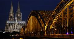 Establishing Shot Illuminated Night Light Cologne Cathedral Skyline Birds Flock Stock Footage