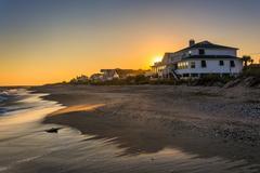 sunset over beachfront homes at edisto beach, south carolina. - stock photo