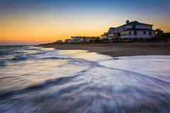 waves in the atlantic ocean and beachfront homes at sunset, edisto beach, sou - stock photo