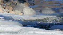 Stock video 4K freezing mountain river Stock Footage