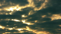 Drama sun through clouds in sky. Time lapse in red tones Stock Footage