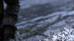 A fisherman walks into the water and casts his rod out during winter Stock Footage