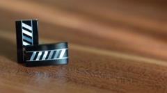 Taking a leather belt from wooden table with male accessories Stock Footage