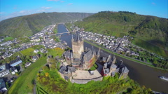Medieval European castle aerial shot village vine hills clouds Stock Footage