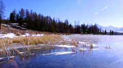 Stock video footage Imovie flight camera above the transparent lake ice Stock Footage