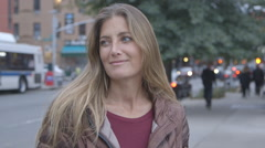 A pretty, middle aged woman smiling into the camera on a Brooklyn street Stock Footage